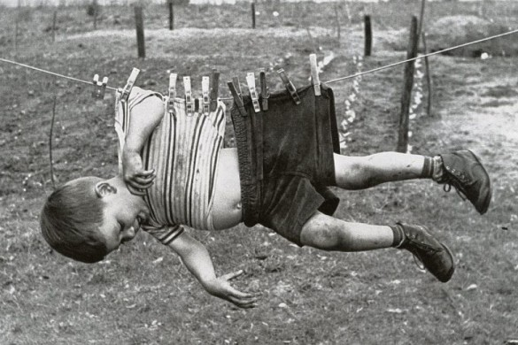 Boy on clothesline, ca_opt