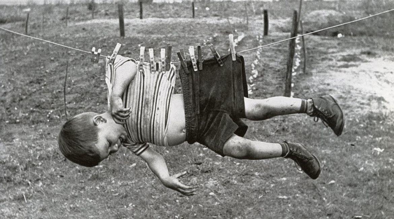 Boy on clothesline, ca_opt